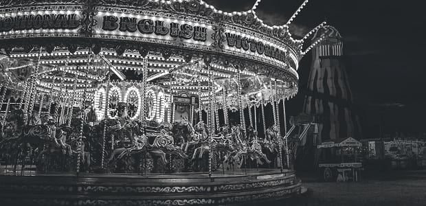 A black and white carousel at night