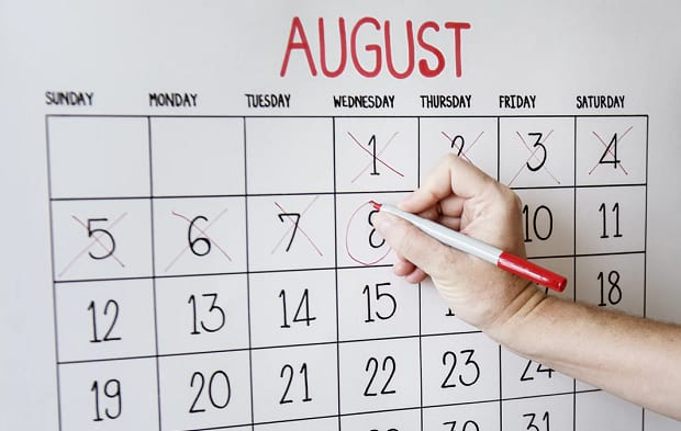 An August calendar with several days marked off and the 8th being circled with a marker